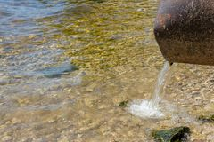 Discharge of toxic or contaminated water into a river or lake. stock photo