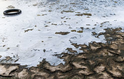 Toxic Pollution and environmental degradation. Polluted water and left waste Stock Photo