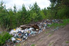 Pollution of the forest by household rubbish. A pile of garbage in the forest. The global problem of pollution royalty free stock photos