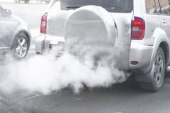Free Pollution From The Exhaust Of Cars In The City In The Winter. Smoke Stock Photos - 169387873
