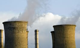 Pollution - industrial towers releasing toxic gas. Cooling Towers at an electricity generating station Stock Photography