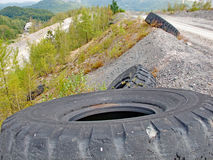 Pollution of the natural environment by discarded worn tires Stock Photography