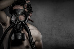 Pollution, nuclear disaster, man with gas mask, protection Stock Photos