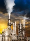 Pollution from oil refinery. Toxic fumes pollution from industrial oil refinery smokestack in concept of global warming stock photos