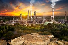 Pollution from oil refinery. Toxic fumes pollution from industrial oil refinery smokestack in concept of global warming stock images