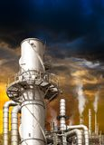 Pollution from oil refinery. Toxic fumes pollution from industrial oil refinery smokestack in concept of global warming stock photo