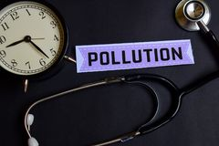 Pollution on the paper with Healthcare Concept Inspiration. alarm clock, Black stethoscope. stock photo