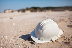 Pollution - Plastic Hard Hat on Beach Royalty Free Stock Photography