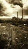 Pollution from power plant near train rail. Pollution from power plant in industrial area near train rail stock photos