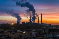 Pollution from power plant at sunrise Stock Images