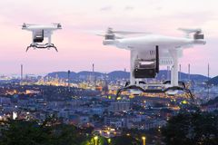 Pollution sensor drone flying to survey on industry zone. Technology 4.0 concept royalty free stock photography