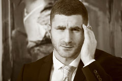 Pollution sickness. Stressed man holding head royalty free stock photography