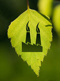 Pollution sign with green leaf Stock Photos