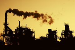 Pollution Silhouette. A silhouette of a factory emiited gas into the atmosphere Stock Photos