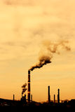 Pollution smoke. Global warming concept in sepia.Pollution smoke from factory Stock Photo
