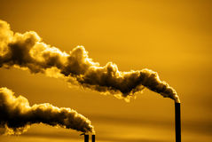 Pollution and Smoke from Chimneys of Factory or Power Plant Royalty Free Stock Photography