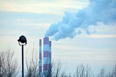 Industrial smoke stack of coal power plant. Pollution and smoke from chimneys of factory or power plant Stock Photography