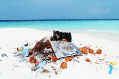 Pollution on a tropical beach Royalty Free Stock Photography