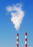 Pollution. Two smoking chimneys pollution air Royalty Free Stock Photo