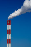 Pollution. Vertical. The chimney of a factory with white smoke. Vertical Stock Photos