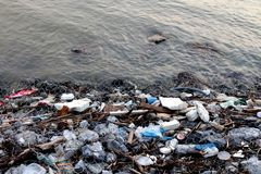 Waste seaside Pollution, Garbage on beach, Waste trash in river, Toxic waste, Wastewater, Dirty water in river. Pollution Waste seaside, Garbage on beach, Waste Stock Photo