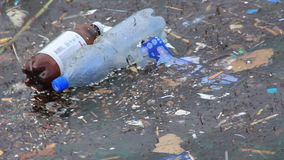 Pollution water. Plastic bottles and other trash in pollution water stock footage