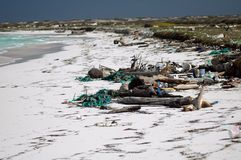 Pollution on white beach Royalty Free Stock Photography