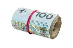 Polnische Banknoten von 100 PLN rollten mit Gummi Stockfotos