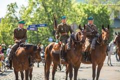 Polnische Kavallerie während des Jahrbuches des polnischen nationalen und gesetzlichen Feiertages der Konstitutions-Tag am 3. Mai Lizenzfreies Stockfoto