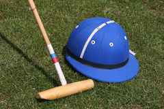 Polo Helmet and Malet. Blue Polo Helmet and malet used in the game of Polo Royalty Free Stock Images