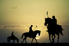 Polo players on horses Stock Photo