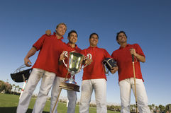 Polo Players With Trophy. Low angle view of male polo players with trophy on field stock images