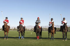 Polo Players And Umpire On Field Royalty Free Stock Images