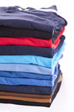 Polo shirts. Various colours isolated Royalty Free Stock Photo
