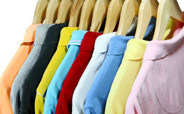 Polo shirts. Colorful polo shirts for men on hanger isolated over white Stock Photos