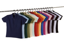 Polo-Shirts on Hangingrail. Shot in the studio in front of white background. The object is isolated Stock Photography