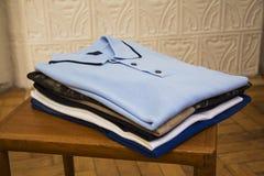 Polo shirts in shop Stock Photos