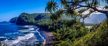 Pololu Valley Hawaii Panorama. Panorama overlooking Pololu Valley, Big Island Hawaii, USA shows waves clashing against a beautiful volcanic black sand beach Royalty Free Stock Photo