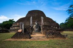 Polonnaruwa Ancient City, stone Buddha statue at the Tooth Relic Chamber. Hatadage in Polonnaruwa Quadrangle, UNESCO World Heritage Site, Sri Lanka, Asia. This royalty free stock image