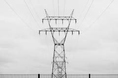 Polos da eletricidade e fios e cerca Fotos de Stock Royalty Free