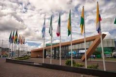 Polos de bandeira no centro de Lago Agrio Equador Fotografia de Stock Royalty Free