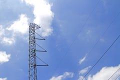 Polos de poder de acero con el cielo azul Imagen de archivo