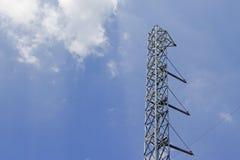 Polos de poder de acero con el cielo azul Fotos de archivo libres de regalías