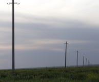 Polos de poder en la puesta del sol Imagen de archivo libre de regalías
