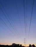Polos de poder no crepúsculo Foto de Stock