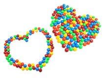 Polos del chocolate en dimensiones de una variable del corazón Imágenes de archivo libres de regalías