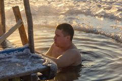Swimming in the hole for the baptism of the Lord. 19.01.14 Polotsk Belarus. Swimming in the hole in the morning in the cold on the feast of the Baptism of the royalty free stock photo