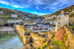 Polperro Cornwall England with houses and harbour wall in HDR like painting Royalty Free Stock Photography