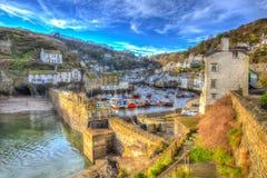 Polperro Cornwall England med hus och hamnväggen i HDR gillar att måla Royaltyfri Fotografi
