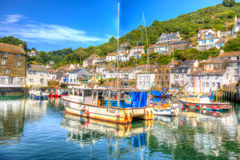 Polperro harbour Cornwall England with clear blue and turquoise sea in vivid colour HDR like painting Stock Images